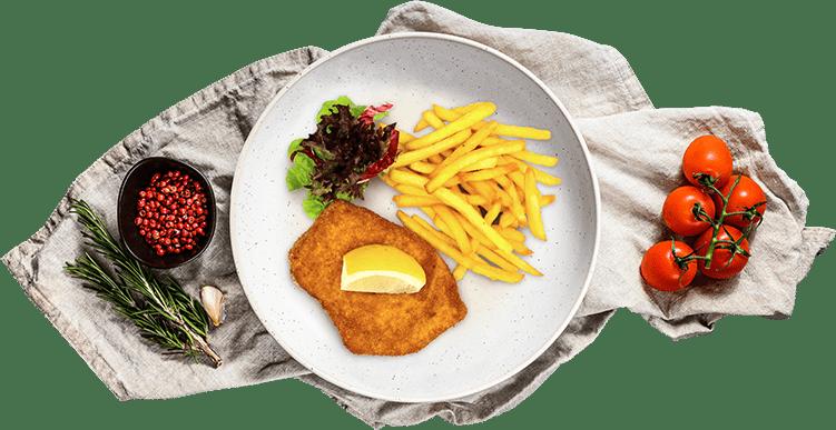 Teller mit Essen auf einem Tuch mit Deko